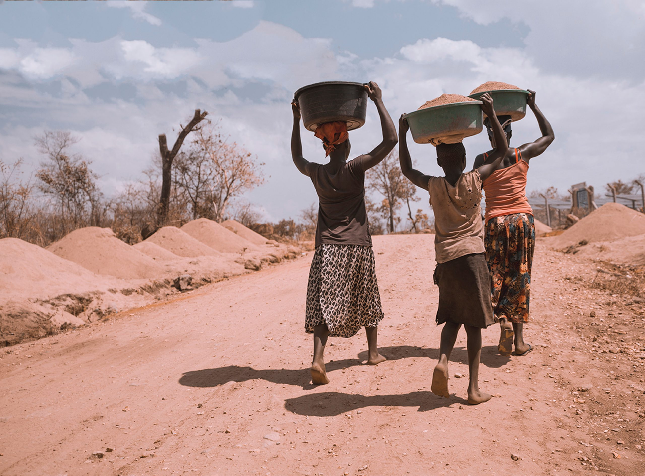 Three People in Africa carrying tubs